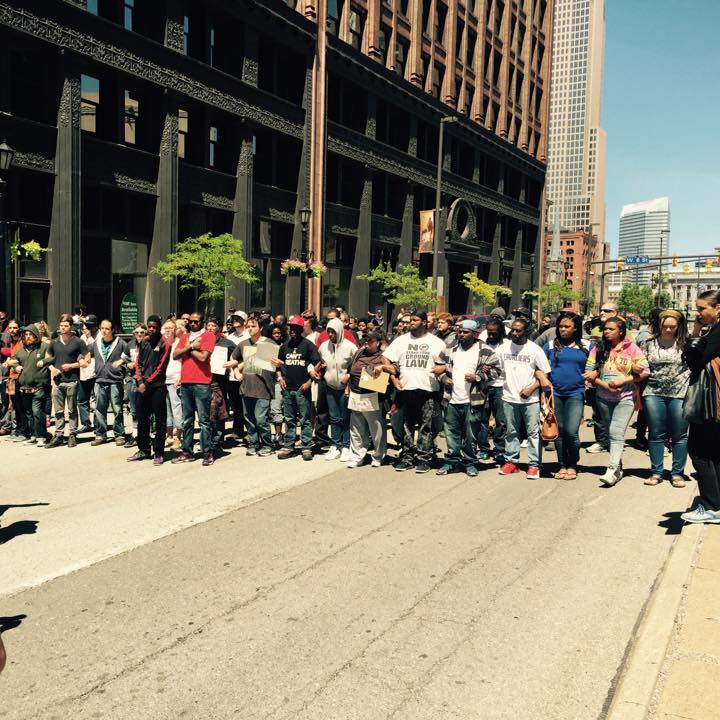 A BMLP Legal Observer observing protestors locking arms and blocking a street in Cleveland